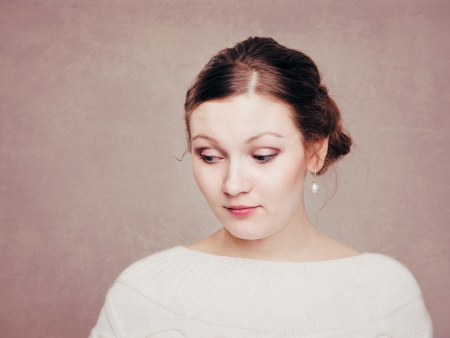 bashfulness: Portrait of the young woman with a pearl ear ring