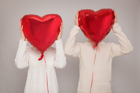 The girl and the guy with balloons in the form of heart