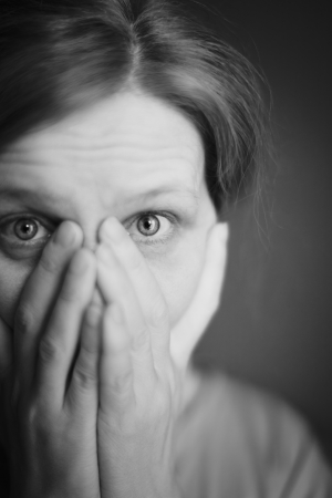 The surprised or scared woman covering her mouth by her hands  Stock Photo