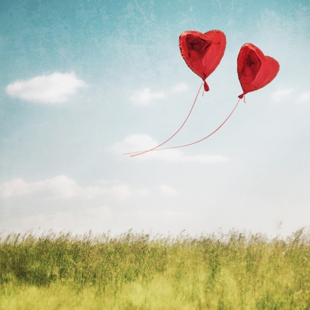 Love Heart balloon in vintage blue sky  photo