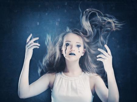 daunting: halloween face art girl on black background