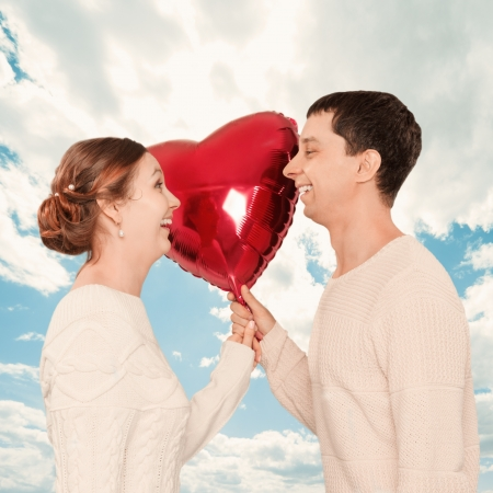 The girl and the guy with balloons in the form of heart photo