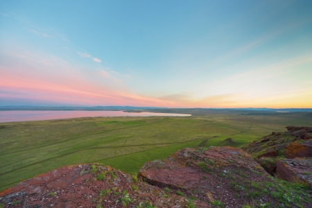 spaciousness: Mountains and steppes Hakassii, sunset
