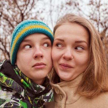 funny portrait of teenage young couple outdoors