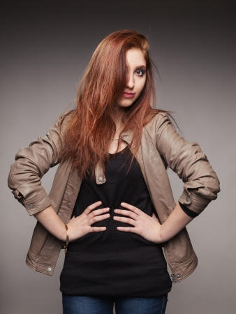 Portrait of the young girl in a leather jacket representing model Stock Photo