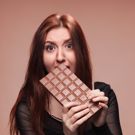 Portrait of the young girl with  big chocolate Stock Photo