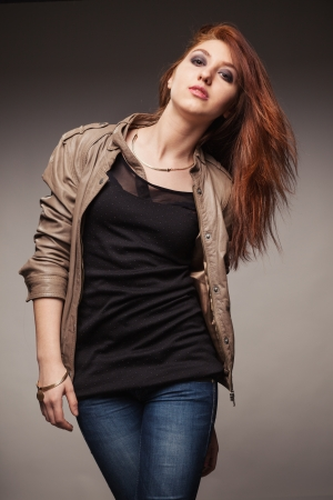 Portrait of the young girl in a leather jacket photo