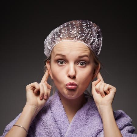 Funny girl wearing bathing cap  photo