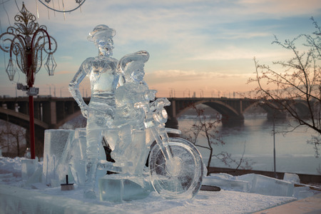 Don Quixote and it squire on a bicycle, a sculpture from ice  on quay of Yenisei in the city of Krasnoyarsk, Siberia, Russia