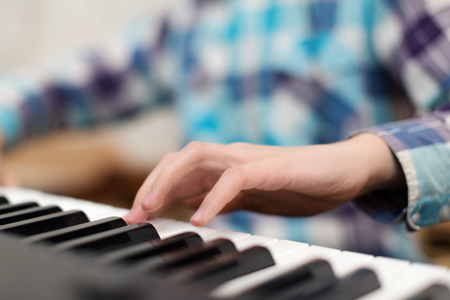 closeup shot of male hands playing the piano