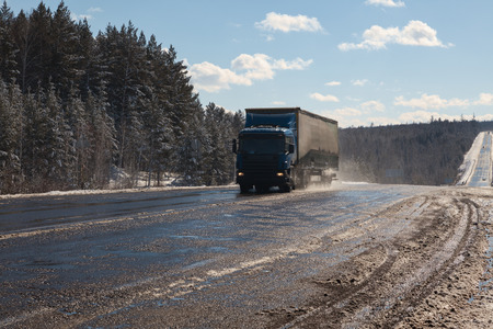 sleet: Lorry  on the muddy road Stock Photo