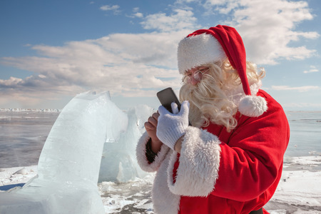 Santa Claus  that calls to whom by phone  photo