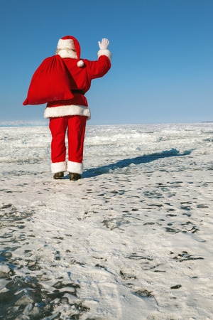 conducted: Santa Claus goes, the holiday is over,  shooting was conducted in a sunny day on lake Baikal Stock Photo