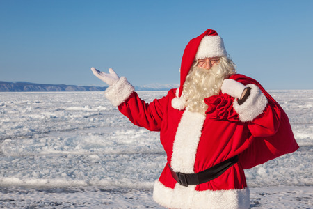 conducted: Santa Claus,  a pointing gesture,  shooting was conducted in a sunny day on lake Baikal Stock Photo