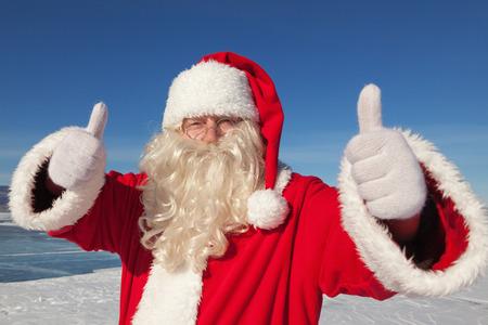 Portrait of Santa Claus outdoors gesture raised thumb Banco de Imagens