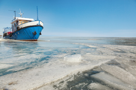 conducted: Metal ship in ice, shooting was conducted in a sunny day on lake Baikal Stock Photo
