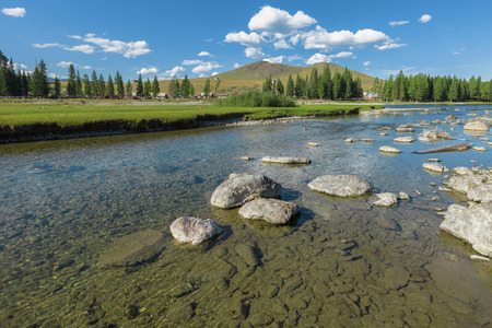 ulagan: River near the village of Ulugun in the Altai Mountains, a summer day