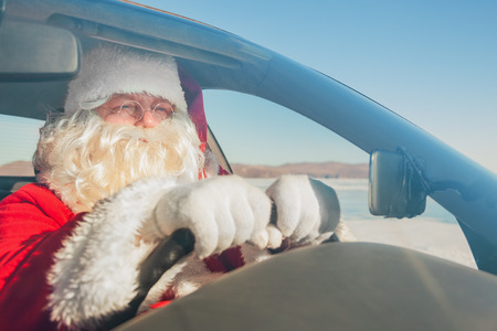 Portrait of Santa Claus in the car, shooting was conducted in a sunny day on lake Baikal Stock Photo