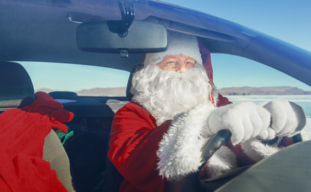 Portrait of Santa Claus in the car, shooting was conducted in a sunny day on lake Baikal photo