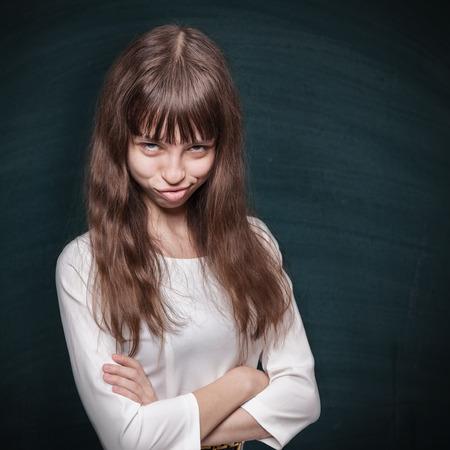 stubborn: Stubborn schoolgirl looks askance and grins