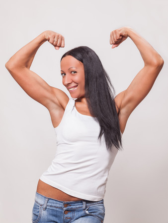 arm muscles: young woman showing what her arm muscles