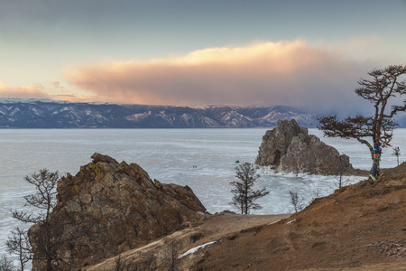 Tree of desires on cape Burhan of Olkhon Island on Lake Baikal, Russia photo