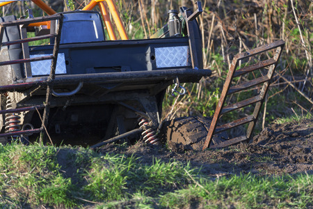 insurmountable: Extreme offroad car at competitions in mud