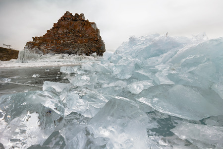 global cooling: Rocks frozen into the ice of siberian Baikal Lake in winter