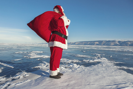 conducted: Santa Claus on ice of lake Baikal, shooting was conducted in a sunny day on lake Baikal