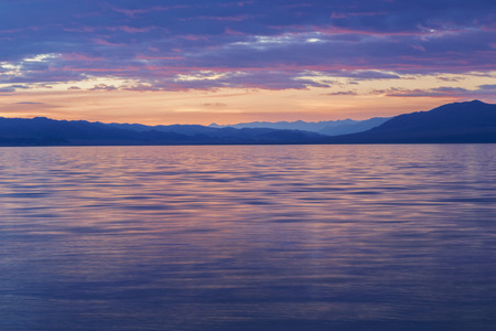 Sunset on Lake Uureg Nuur in the mountains of Mongolia Stock Photo