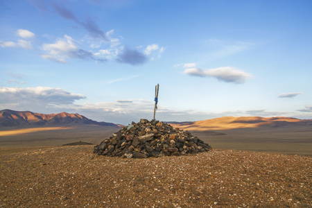 reference point: A pile of stones serving as a reference point on a mountain road in Mongolia