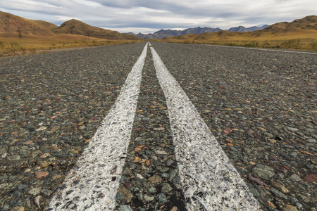 Asphalt road in a mountainous area on the border between Russia and Mongolia Stock Photo