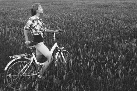 simple girl: Simple teen girl on a bicycle in a summer field