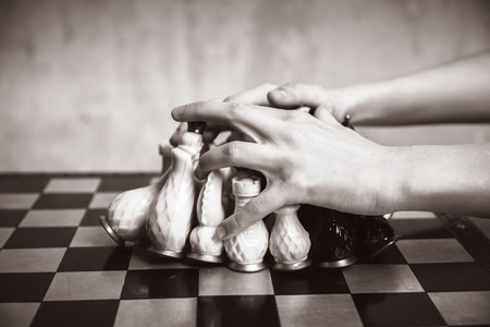 playing chess: Playing chess, close-up, black-and-white photo Stock Photo