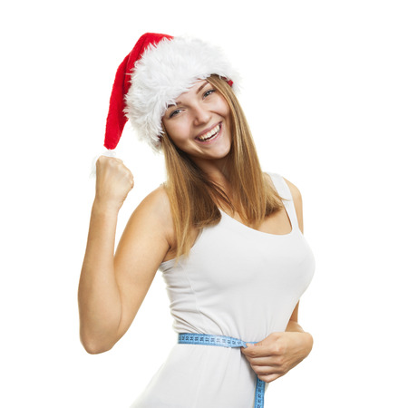female christmas: Girl in a red Santas cap with a measuring tape around your waist