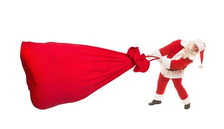 generosidad: Santa Claus con una gran bolsa de regalos, aislado en blanco Foto de archivo