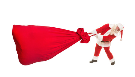 Santa Claus with a very large bag of gifts, isolated on white Banco de Imagens