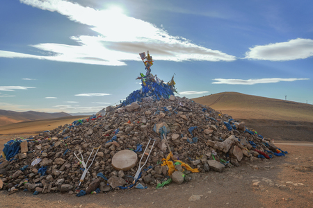 shamanism: Ritual pile of stones, oboo, at the entrance to Terelj National Park, Mongolia Stock Photo