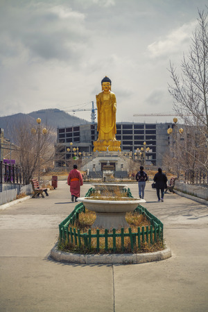 Golden statue of young Buddha near the hill Zaisan in , BUDDHA PARK, center of cultural and religious heritage Zanabazar