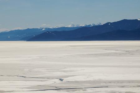 cracks in ice: First cracks in the ice of Lake Baikal in spring Stock Photo