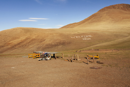 debris: The inscription Welcome and debris on the hill in front of the National Park Gorkhi-Terelj, Mongolia