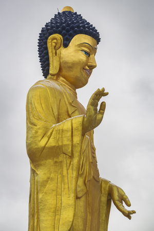 Golden statue of young Buddha near the hill Zaisan in, BUDDHA PARK, center of cultural and religious heritage Zanabazar