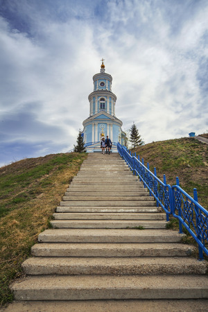 Thelma village, Irkutsk region, Russia - MAY September 2016:? Two students walking down the stairs near the Church of the Kazan Icon of the Mother of God.