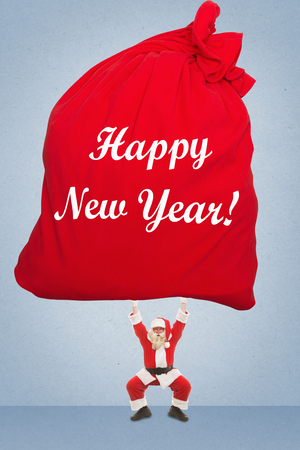Santa Claus holds over a very large bag with gifts, on which is written in the New Years greetings