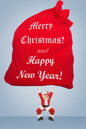 Santa Claus holds over a very large bag with gifts that says congratulations to New Year and Christmas