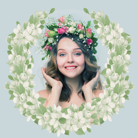 coronet: The girl with a smile in a wreath of pink and white roses in the form of spring emblem on a gray-blue background