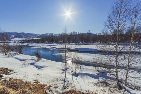 Koksa River flowing near the mountains in early spring, Altai, Russia