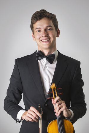 Young musician violinist smiling, looking at camera Archivio Fotografico