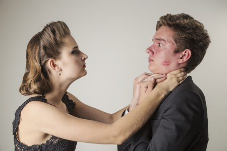 Scene of jealousy, the girl is ready to strangle the young man for the traces of lipstick on her cheek