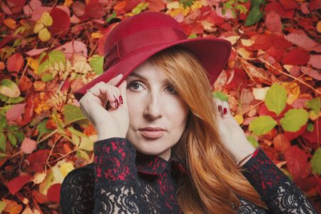Autumn mood of beauty: portrait of a woman in a red hat, close-up, photo collage